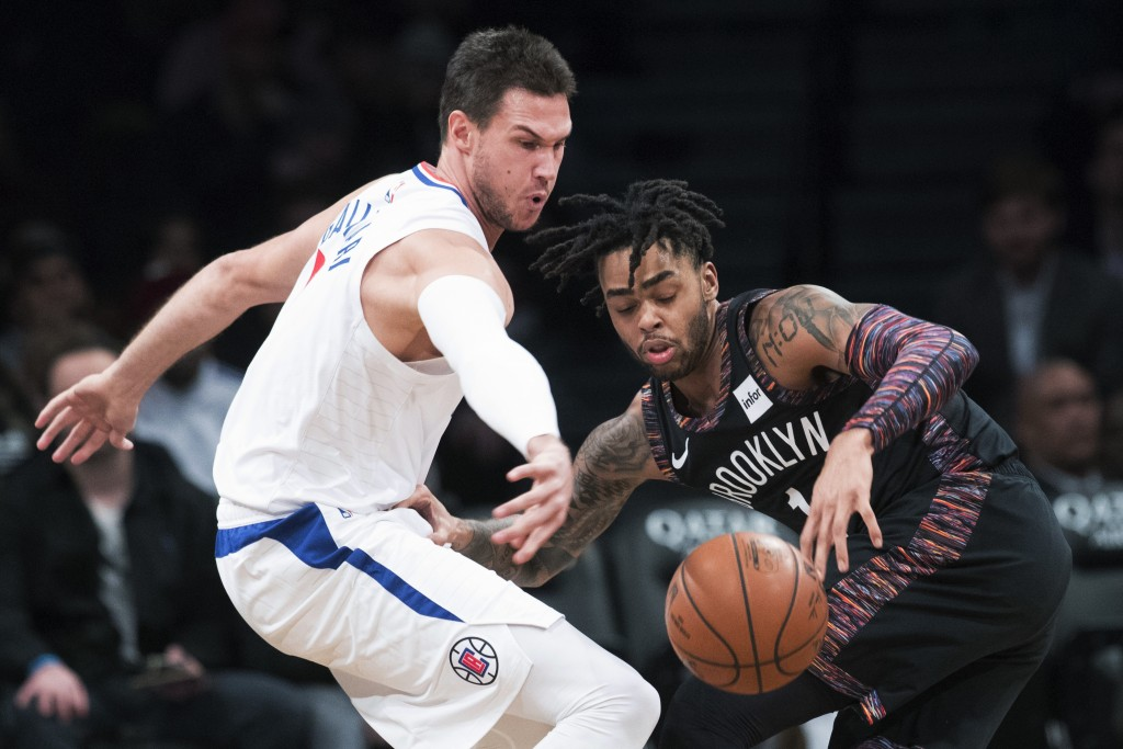 Los Angeles Clippers forward Danilo Gallinari (8) and Brooklyn Nets guard D'Angelo Russell (1) vie for a loose ball during the first half of an NBA ba...