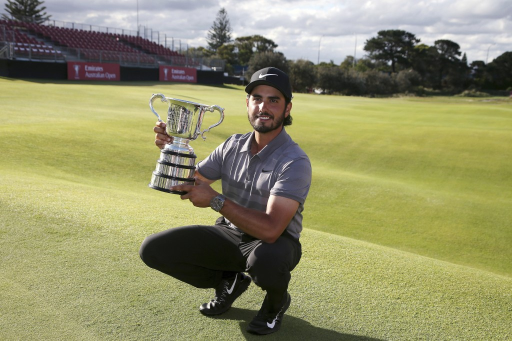 Abraham Ancer of Mexico holds his trophy after winning the Australian Open Golf tournament in Sydney, Sunday, Nov. 18, 2018. (AP Photo/Rick Rycroft)