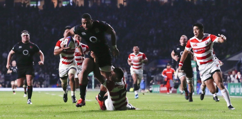 England's Joe Cokanasiga goes over to score a try during the rugby union international match between England and Japan at Twickenham stadium in London...