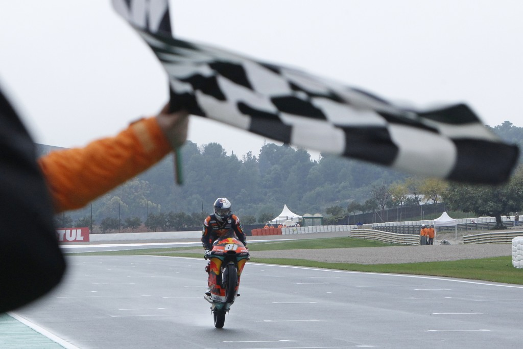 Moto3 KTM rider Can Oncu of Turkey crosses the finish line to win during the Motorcycle Grand Prix at the Ricardo Tormo circuit in Cheste near Valenci...