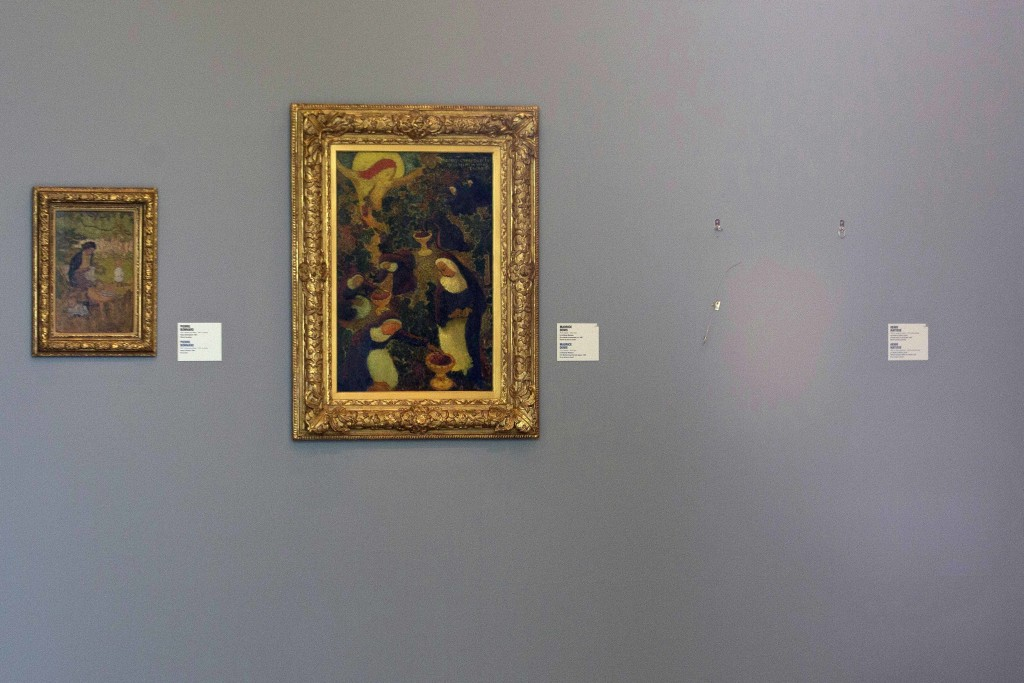 """FILE - In this Tuesday, Oct. 16, 2012 file photo, the empty space where Henri Matisse' painting """"La Liseuse en Blanc et Jaune"""" was hanging, right, is ..."""