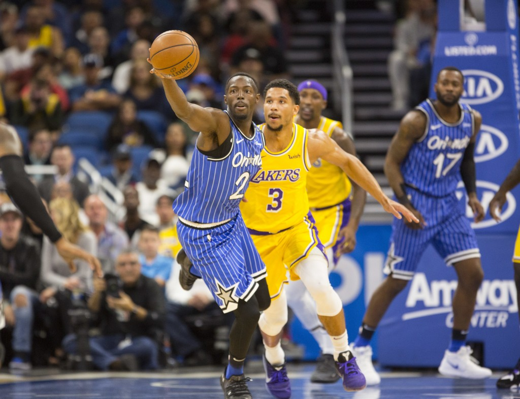 Orlando Magic forward Jarell Martin (2) grabs a loose ball while defended by Los Angeles Lakers guard Josh Hart (3) during the first half of an NBA ba