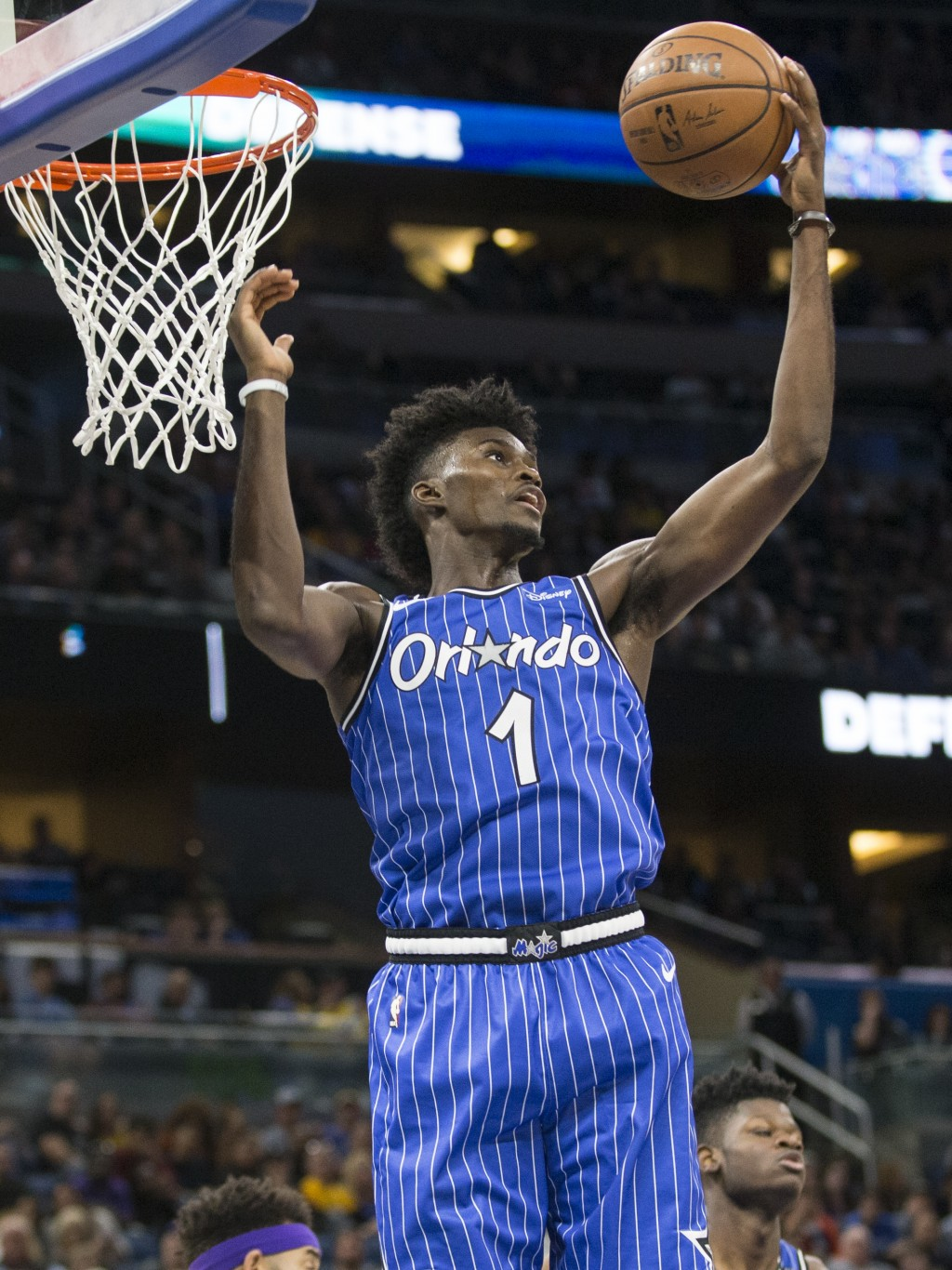 Orlando Magic forward Jonathan Isaac (1) rebounds the ball during the first half of an NBA basketball game against Los Angeles Lakers, Saturday, Nov.