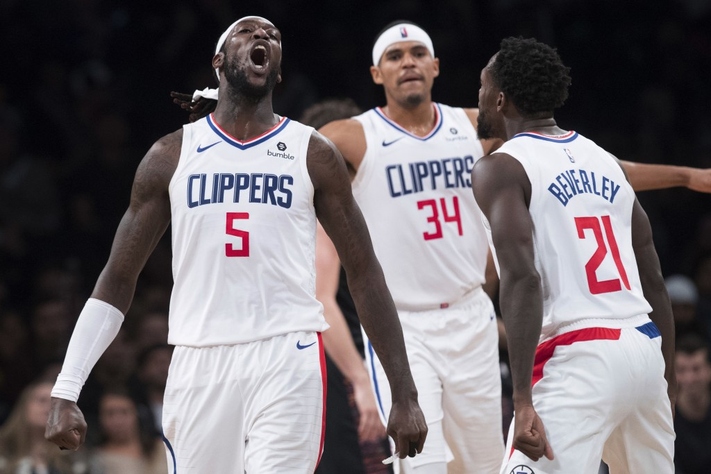 Los Angeles Clippers forward Montrezl Harrell (5) forward Tobias Harris (34) and guard Patrick Beverley (21) react during the final seconds of second ...