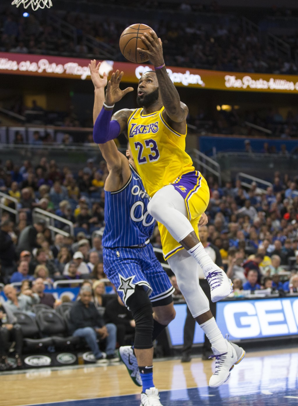 Los Angeles Lakers forward LeBron James (23) takes the ball to the hoop on Orlando Magic forward Aaron Gordon (00) during the first half of an NBA bas