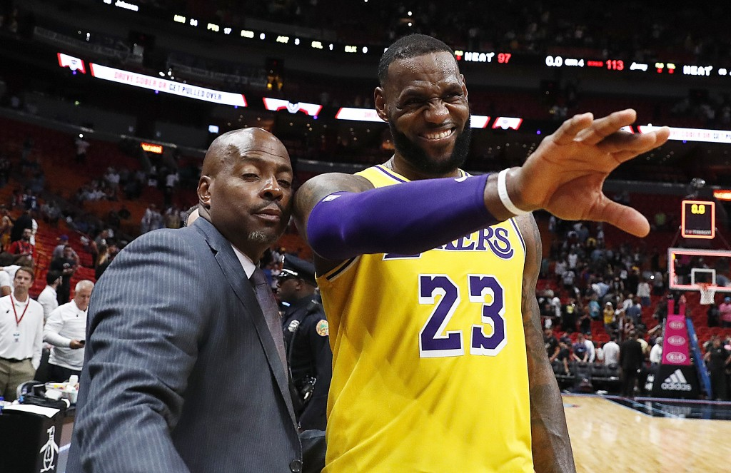 Los Angeles Lakers forward LeBron James waves to a fan after the team's NBA basketball game against Miami Heat on Sunday, Nov. 18, 2018, in Miami. (AP