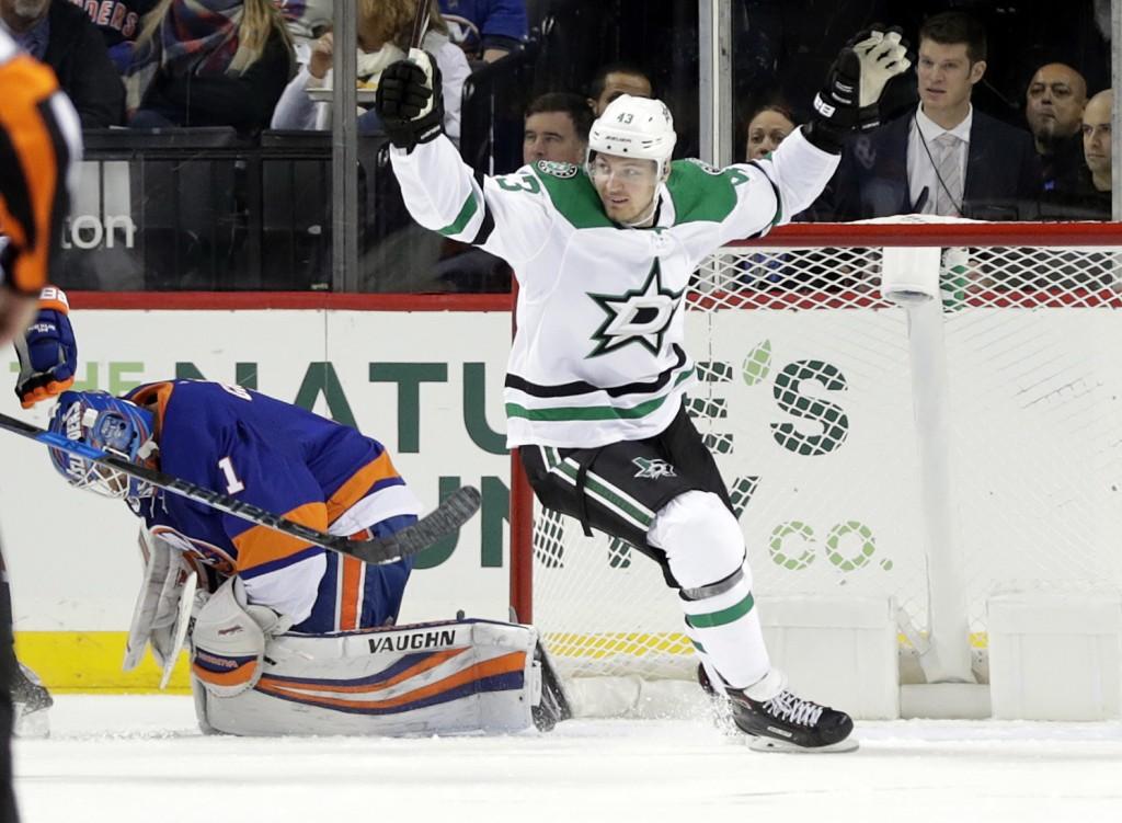 Dallas Stars' Valeri Nichushkin (43) celebrates a goal by teammate Roope Hintz as New York Islanders goaltender Robin Lehner reacts during the second