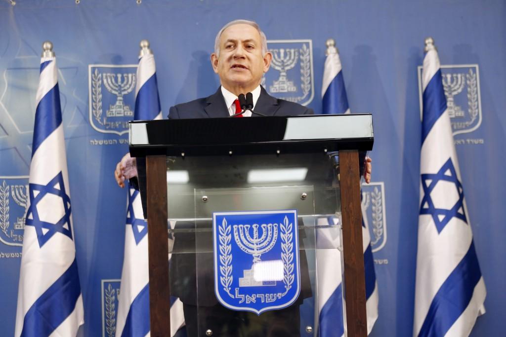 Israeli Prime Minister Benjamin Netanyahu delivers a statement in Tel Aviv, Israel, Sunday, Nov. 18, 2018. Netanyahu says he will take over temporaril
