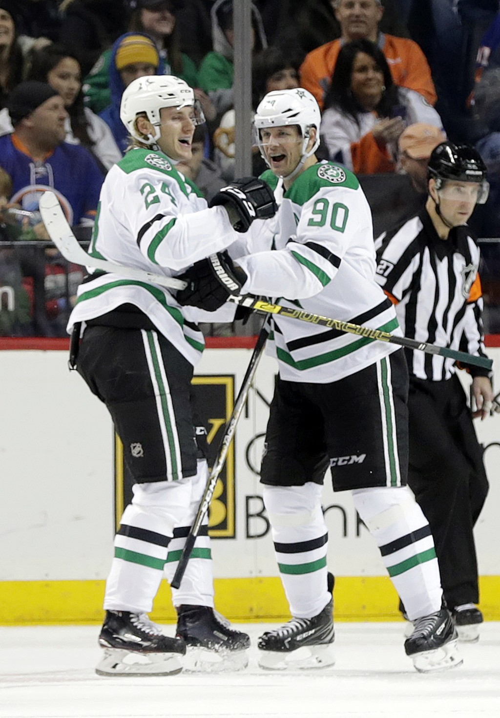 Dallas Stars' Roope Hintz (24) celebrates a goal with teammate Jason Spezza (90) during the second period of an NHL hockey game Sunday, Nov. 18, 2018,