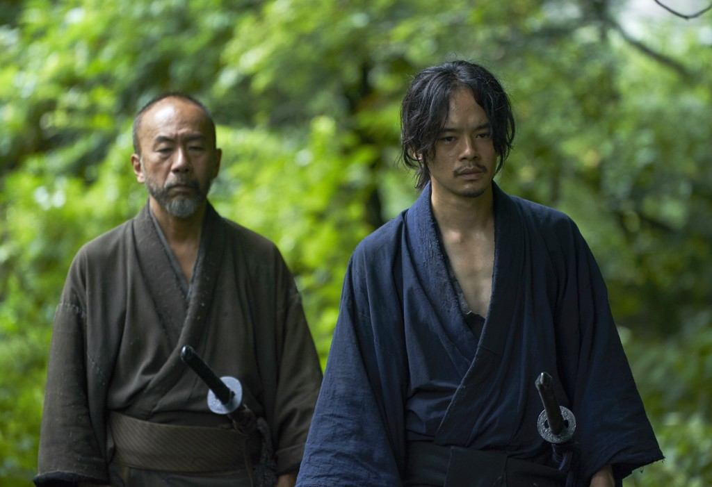 "This photo provided by Nikkatsu Corp., shows Shinya Tsukamoto, left, the director, playing a samurai, and Sosuke Ikematsu in a scene of ""Killing.""  Ja"