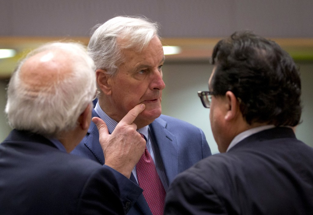 EU chief Brexit negotiator Michel Barnier, center, speaks with Spain's Minister of Foreign Affairs Josep Borrell, left, and Spanish Secretary of State...