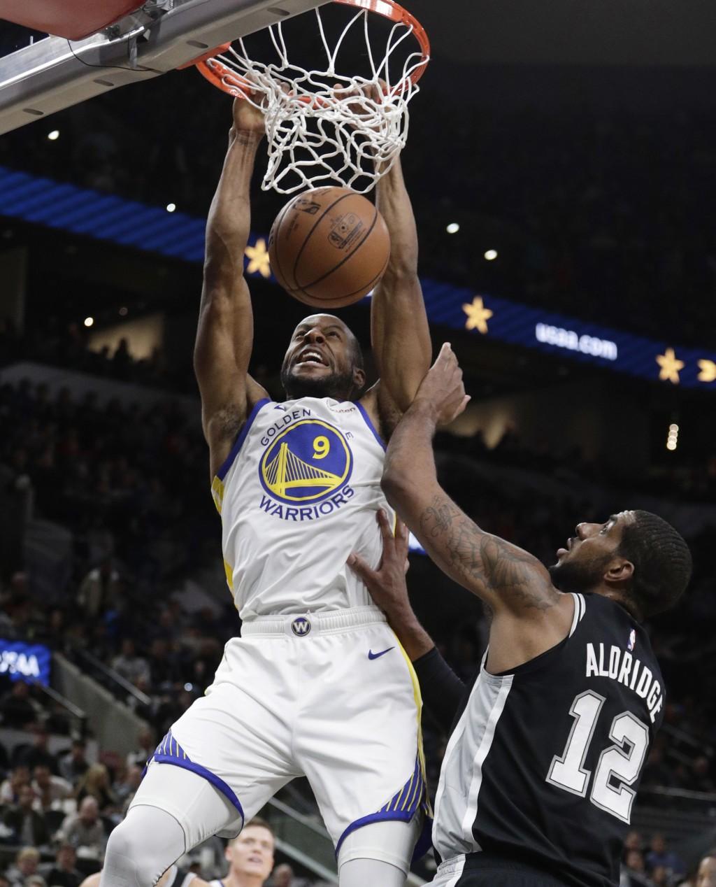 Golden State Warriors guard Andre Iguodala (9) scores over San Antonio Spurs forward LaMarcus Aldridge (12) during the first half of an NBA basketball