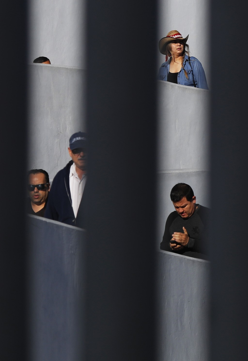 People use a legal border crossing to walk from Tijuana, Mexico to the U.S., Sunday, Nov. 18, 2018. While many in Tijuana are sympathetic to the pligh...