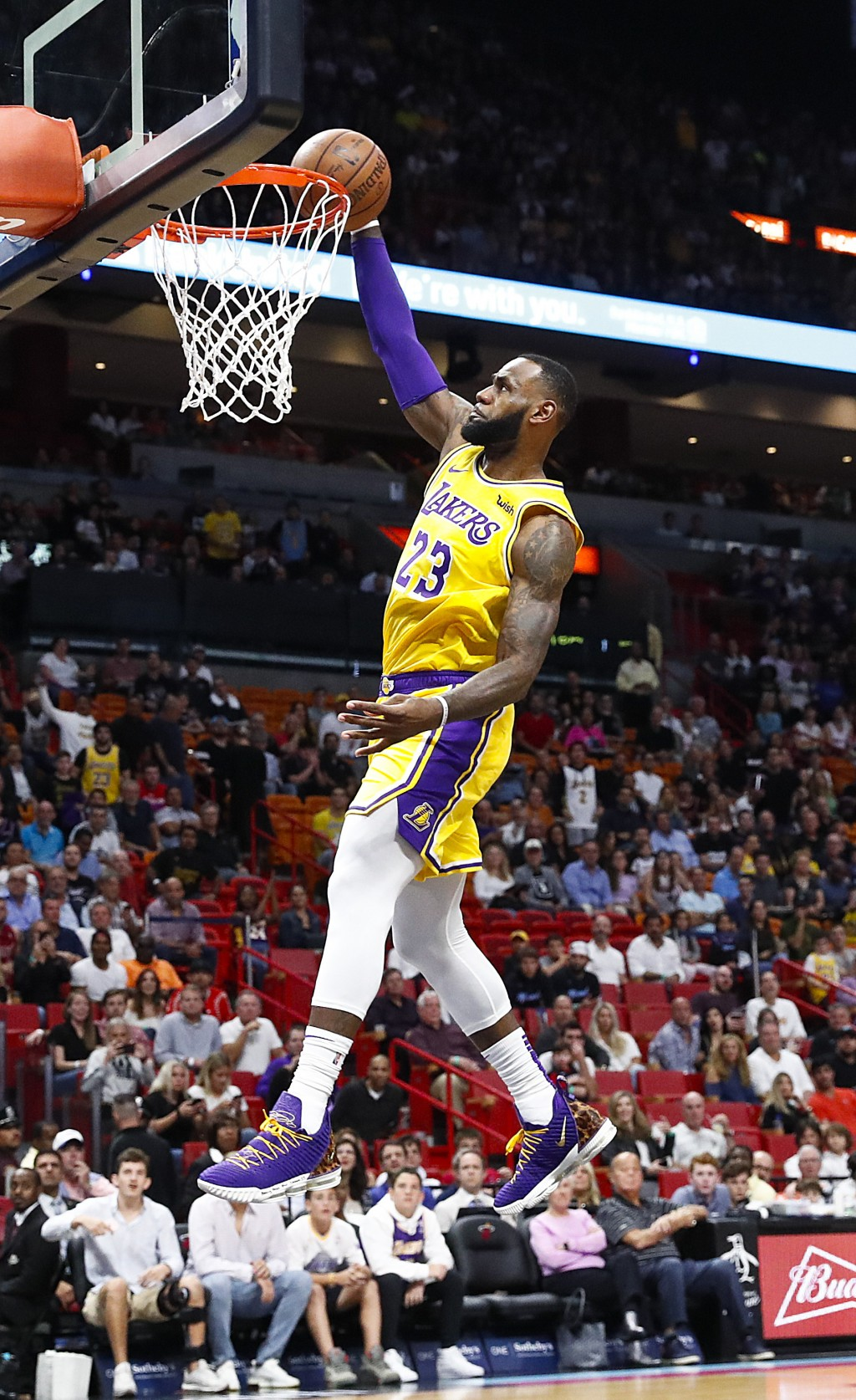 Los Angeles Lakers forward LeBron James scores during the first quarter of an NBA basketball game against the Miami Heat, Sunday, Nov. 18, 2018, in Mi...