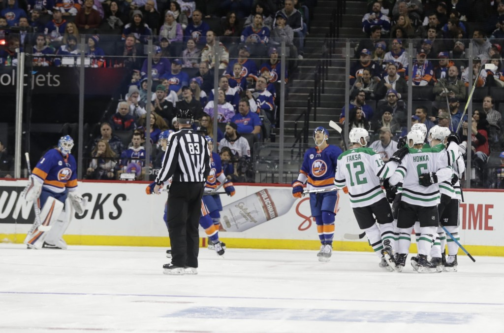New York Islanders goaltender Thomas Greiss, left, watches as the Dallas Stars celebrate a goal by Esa Lindell during the second period of an NHL hock...