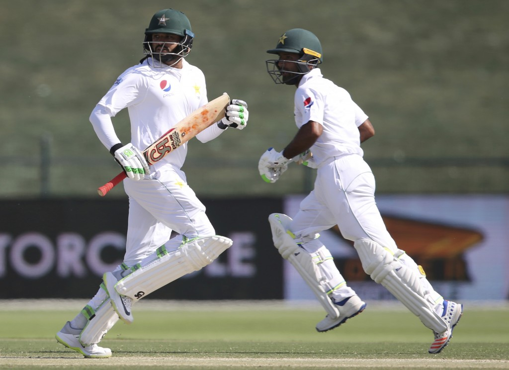 Pakistan's Azhar Ali, left, and Asad Shafiq run between wickets in their cricket test match against New Zealand in Abu Dhabi, United Arab Emirates, Mo...