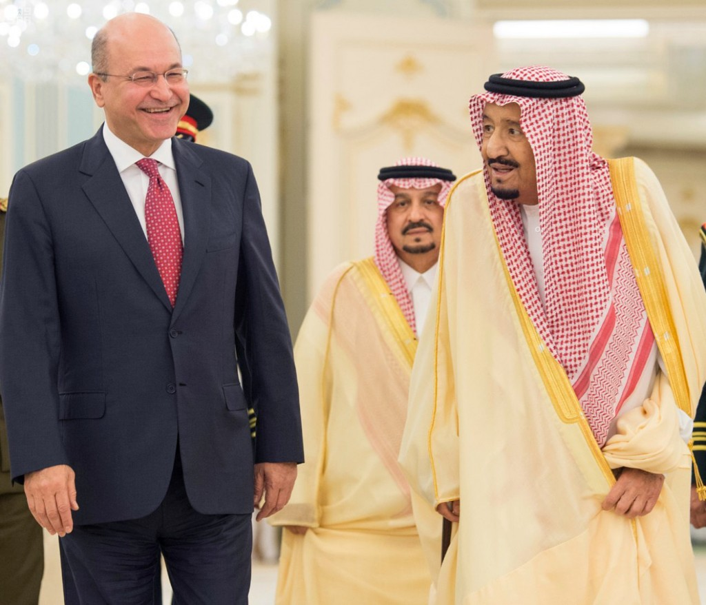 In this photo provided by the Saudi Press Agency, Saudi King Salman, right, walks with with Iraqi President Barham Salih, in Riyadh, Saudi Arabia, Sun...