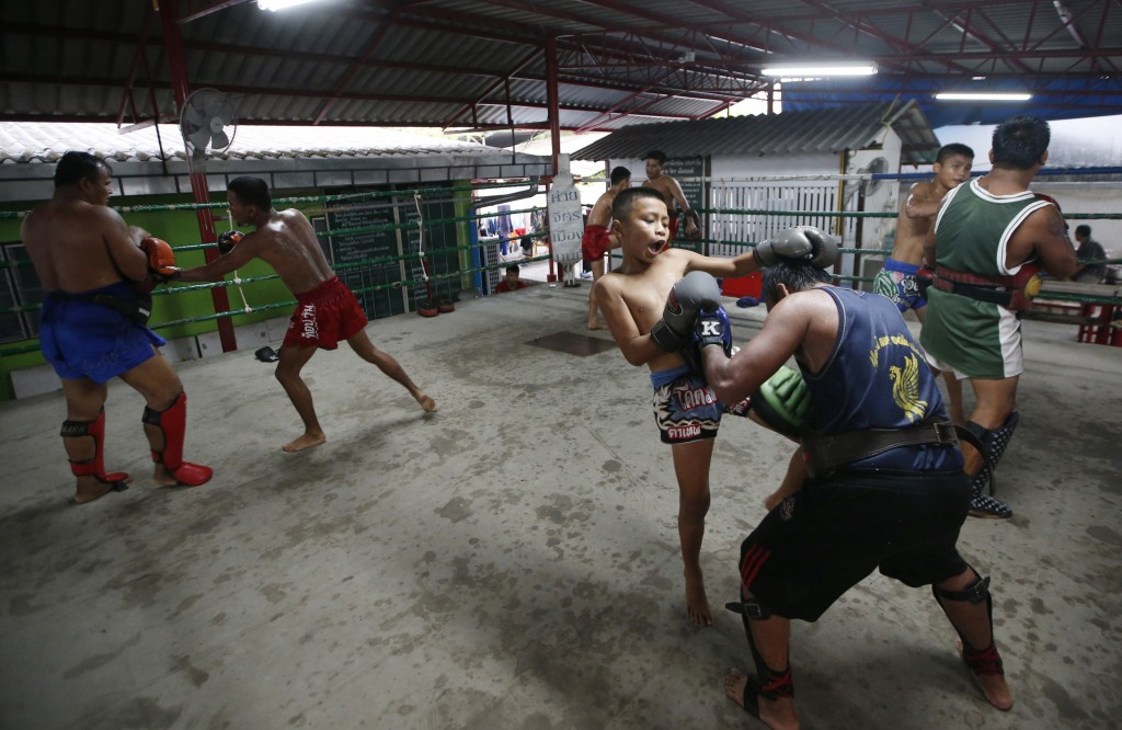 In this Wednesday, Nov. 14, 2018, photo, Thai kickboxer Chaichana Saengngern, 10-years old, practices at a training camp in Bangkok, Thailand. Thai la...