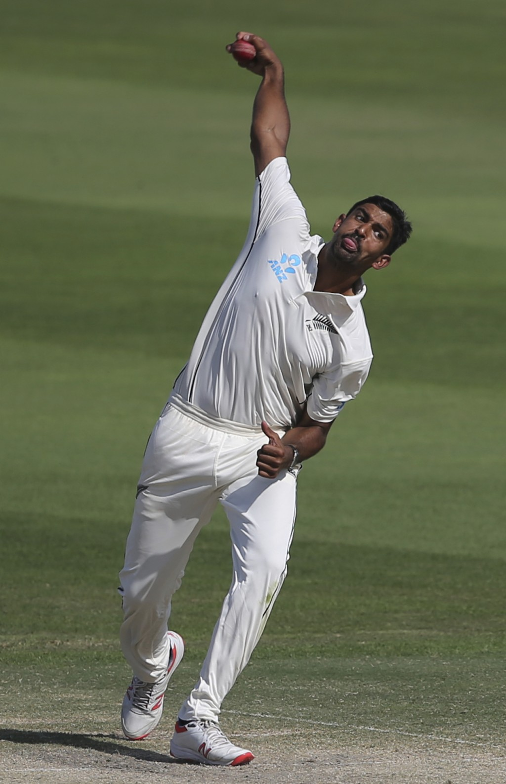 New Zealand's Ish Sodhi throws the ball in their test match against Pakistan in Abu Dhabi, United Arab Emirates, Monday, Nov. 19, 2018. (AP Photo/Kamr