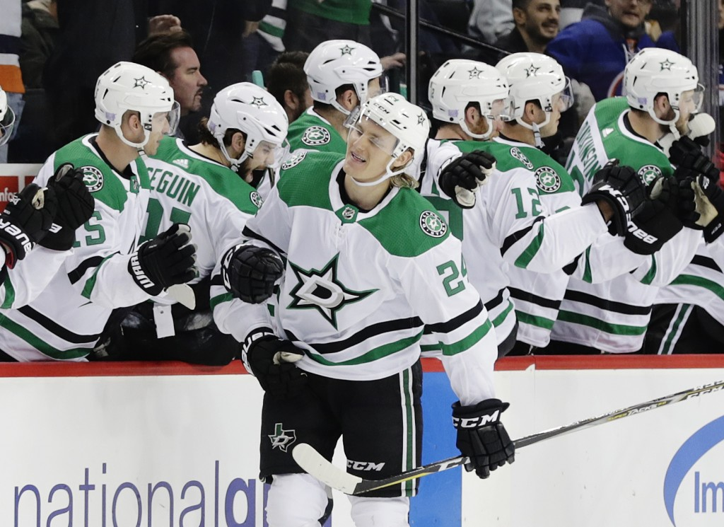 Dallas Stars' Roope Hintz (24) celebrates with teammates after scoring a goal during the second period of an NHL hockey game against the New York Isla