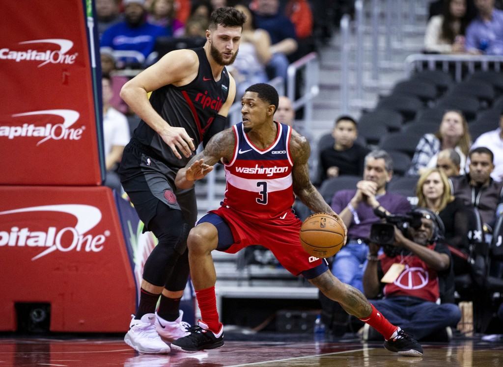 Washington Wizards guard Bradley Beal (3) dribbles past Portland Trail Blazers guard Wade Baldwin IV (2) during the first half of an NBA basketball ga