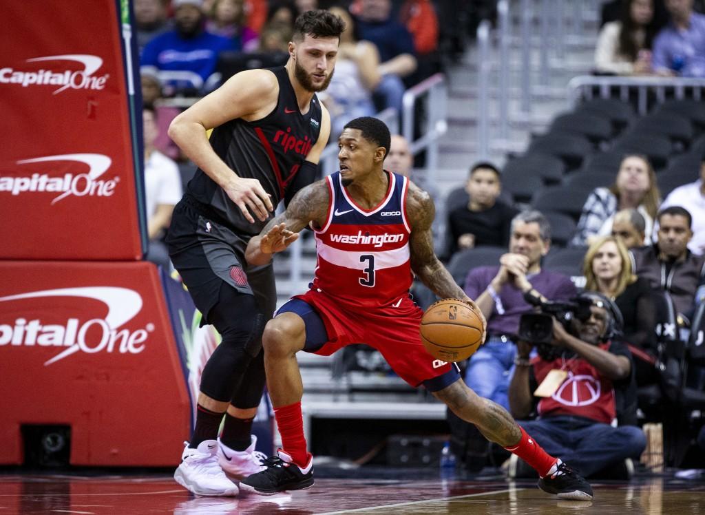 Washington Wizards guard Bradley Beal (3) dribbles past Portland Trail Blazers guard Wade Baldwin IV (2) during the first half of an NBA basketball ga...