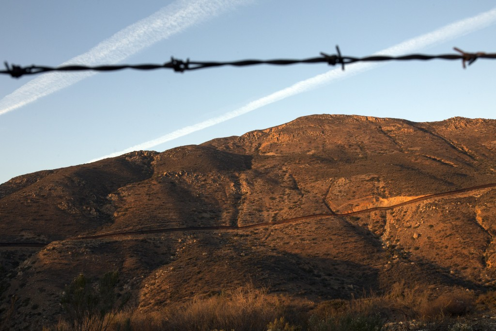 The border fence that divides Mexico with the United States is seen in Tecate, Mexico, Sunday, Nov. 18, 2018. (AP Photo/Rodrigo Abd)