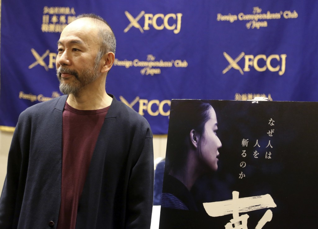 "In this Nov. 7, 2018, photo, Japanese director Shinya Tsukamoto speaks to reporters about his latest film ""Killing"" during a press conference in Tokyo..."