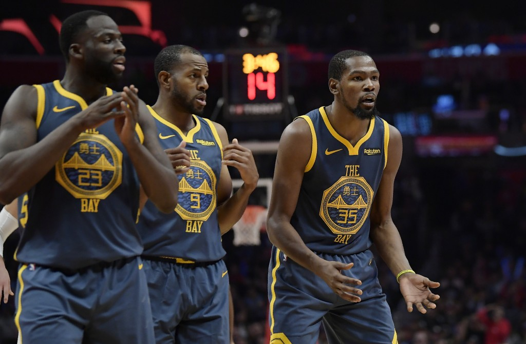 FILE - In this Nov. 12, 2018, file photo, Golden State Warriors forward Kevin Durant, right, reacts as he fouls out of the game while forward Draymond