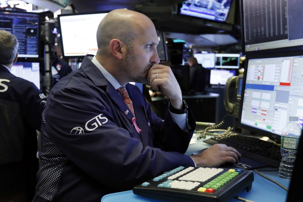 FILE- In this Friday, Nov. 9, 2018, file photo, specialist James Denaro works on the floor of the New York Stock Exchange. The U.S. stock market opens...
