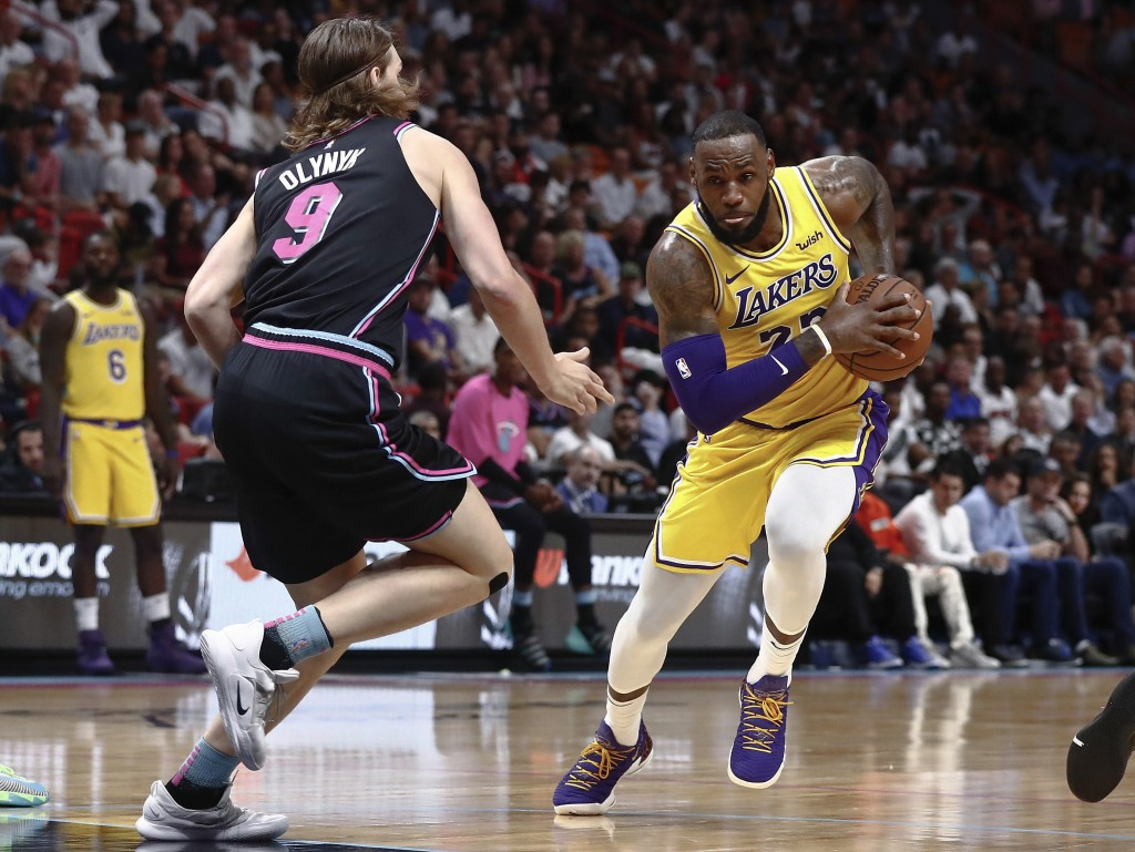 Los Angeles Lakers forward LeBron James drives against Miami Heat forward Kelly Olynyk during the first half of an NBA basketball game Sunday, Nov. 18...
