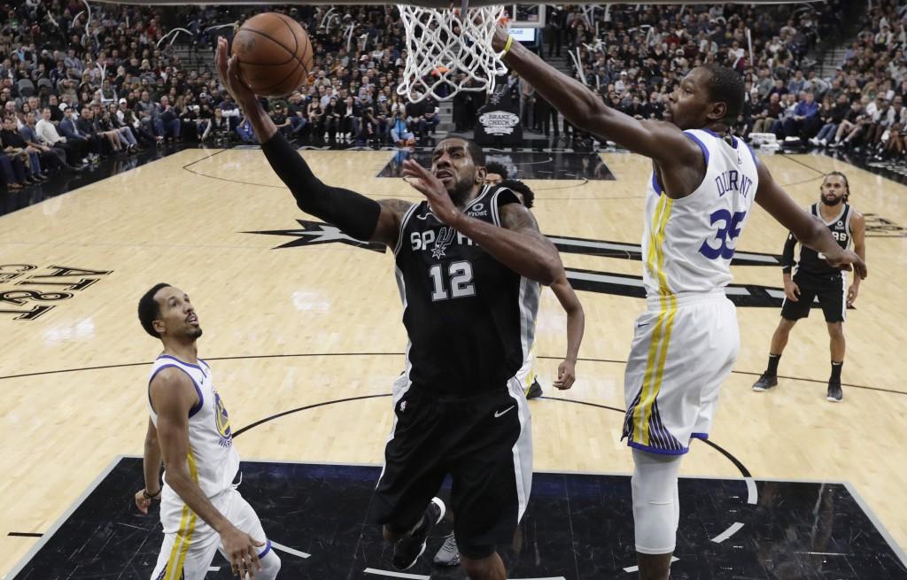 San Antonio Spurs forward LaMarcus Aldridge (12) scores past Golden State Warriors forward Kevin Durant (35) during the second half of an NBA basketba