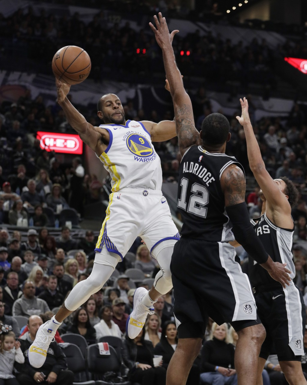 Golden State Warriors guard Andre Iguodala (9) looks to pass the ball as San Antonio Spurs forward LaMarcus Aldridge (12) defends during the first hal
