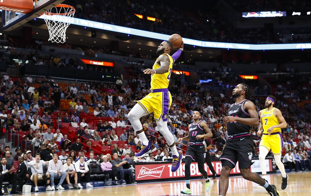 Los Angeles Lakers forward LeBron James scores during the first quarter of an NBA basketball game against the Miami Heat, Sunday, Nov. 18, 2018, in Mi