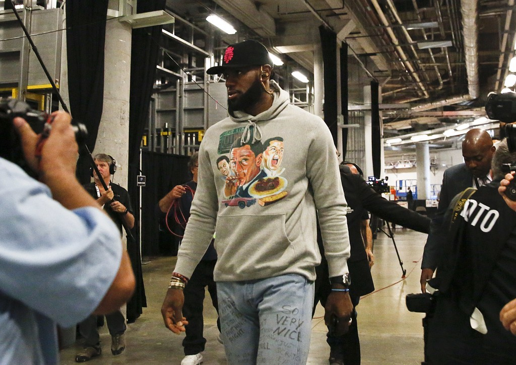 Los Angeles Lakers forward LeBron James arrives before an NBA basketball game against Miami Heat, Sunday, Nov. 18, 2018, in Miami, Fla. (AP Photo/Bryn