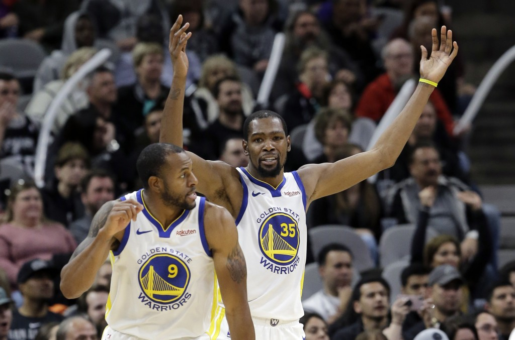 Golden State Warriors forward Kevin Durant (35) and guard Andre Iguodala (9) react to a play during the second half of an NBA basketball game against