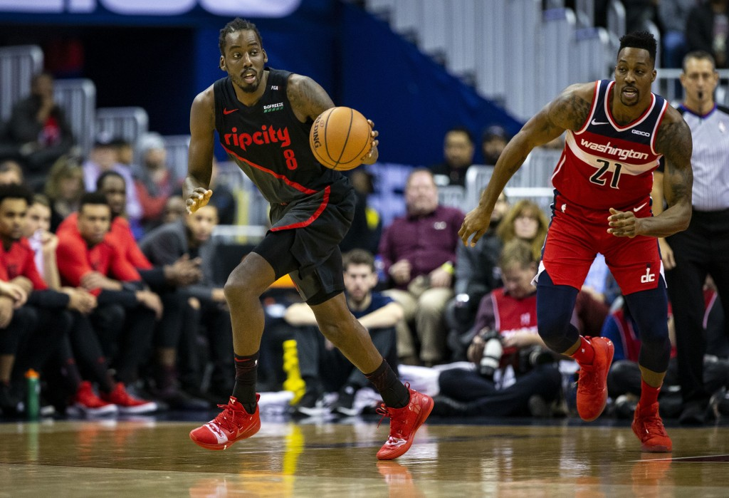 Portland Trail Blazers forward Al-Farouq Aminu (8) dribbles the ball down the court past Washington Wizards center Dwight Howard (21) during the first