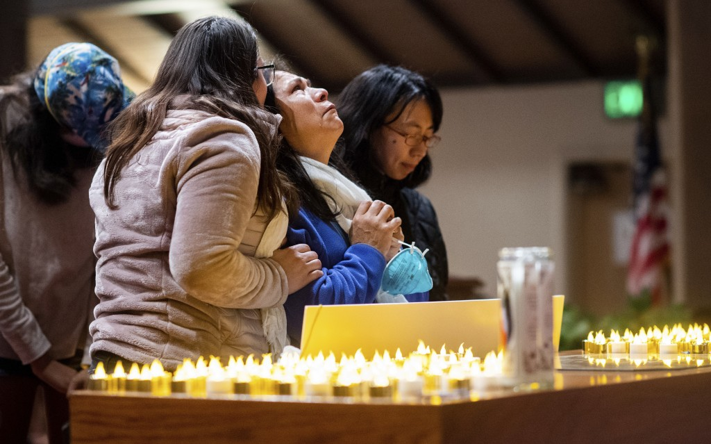 Lidia Steineman, who lost her home in the Camp Fire, prays during a vigil for fire victims on Sunday, Nov. 18, 2018, in Chico, Calif. More than 50 peo...