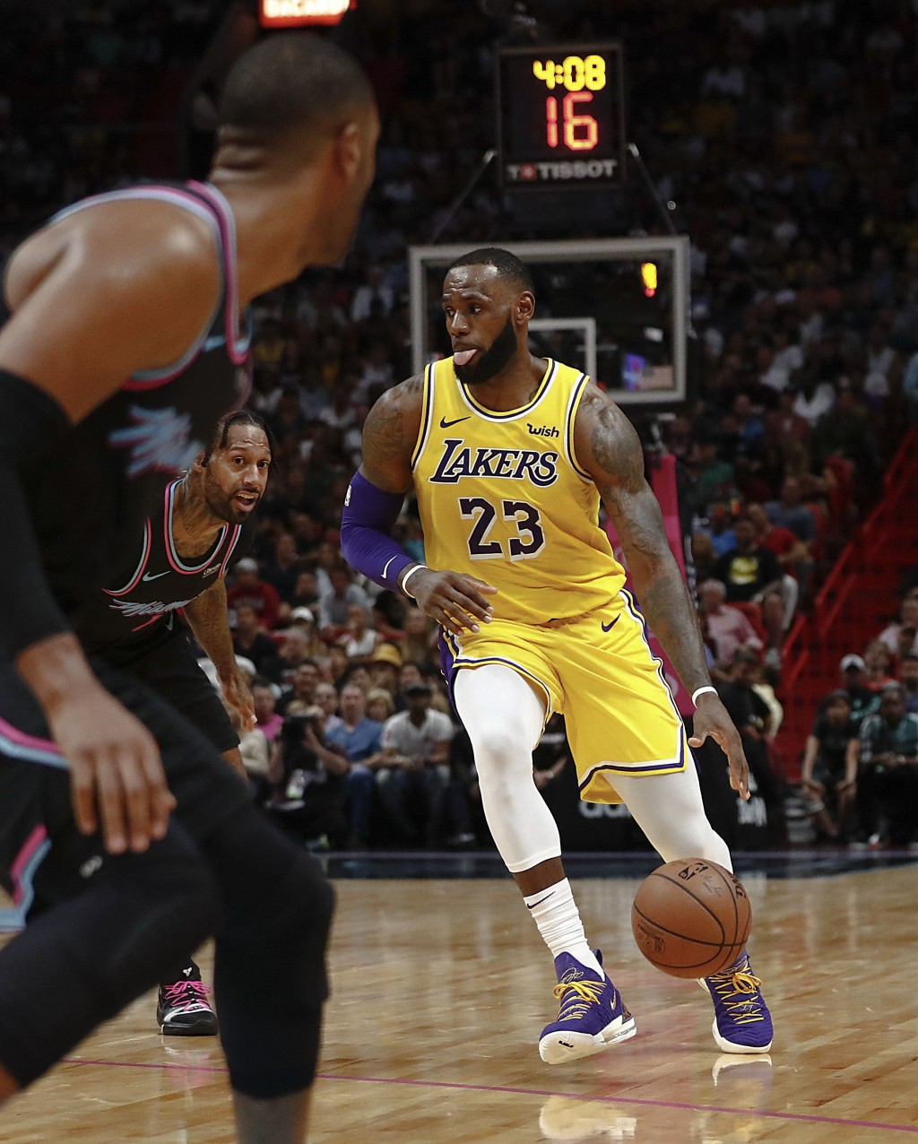 Los Angeles Lakers forward LeBron James dribbles the ball during the first half of the team's NBA basketball game against Miami Heat, Sunday, Nov. 18,...
