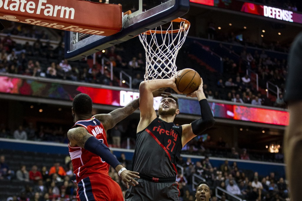 Portland Trail Blazers center Jusuf Nurkic (27) of Bosnia, makes a layup past Washington Wizards forward Markieff Morris (5) during the first half of ...