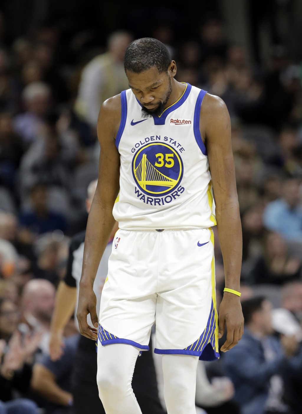 Golden State Warriors forward Kevin Durant (35) walks down court after a play during the second half of an NBA basketball game against the San Antonio