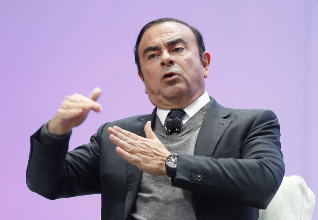 FILE - In this Jan. 9, 2017, file photo, Carlos Ghosn, Chairman of the Board and Chief Executive Officer of Nissan Motor Co., Ltd., speaks at the Nort...