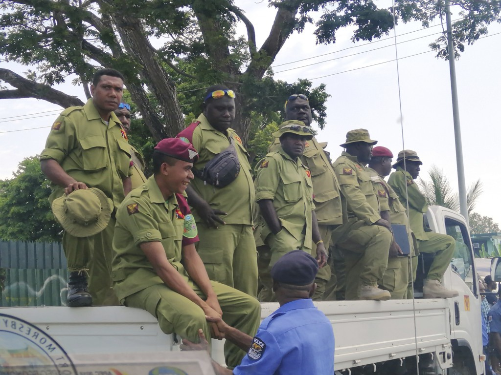 Security personnel on the back of a truck wait to be paid at Rita Flynn Netball Centre in Port Moresby, Papua New Guinea, Tuesday, Nov. 20, 2018.. Opp...
