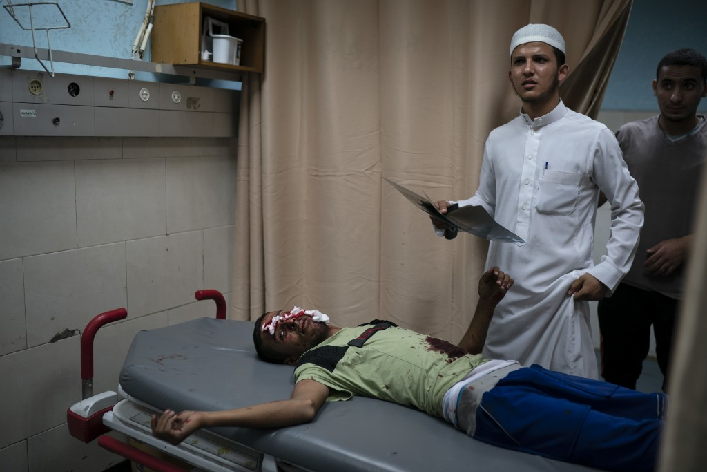 In this Friday, Sept. 14, 2018 photo, a Palestinian receives medical attention in a hospital after being injured during a protest at the Gaza Strip's ...