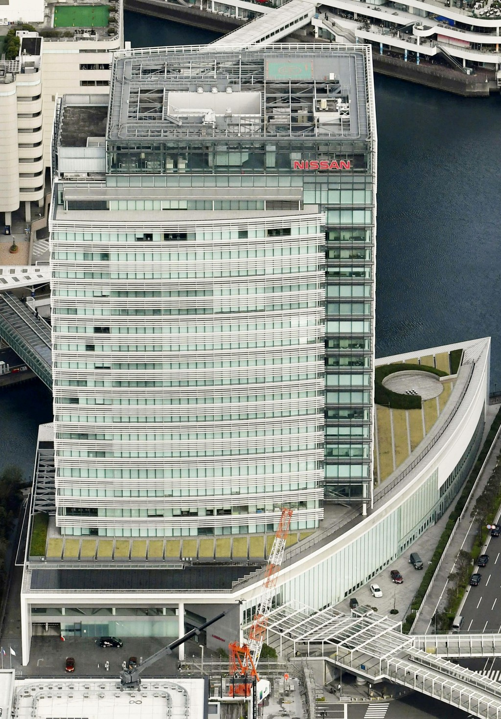 In this aerial photo, Nissan Motor Co. Global Headquarters is seen Tuesday, Nov. 20, 2018 in Yokohama, near Tokyo.  Nissan Chairman Carlos Ghosn, who ...
