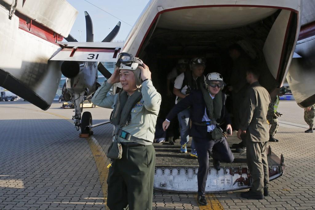 Tan Benhong, a lieutenant general of the People's Liberation Army (PLA) of China, arrives at the Hong Kong airport after visiting the U.S. Navy USS Ro