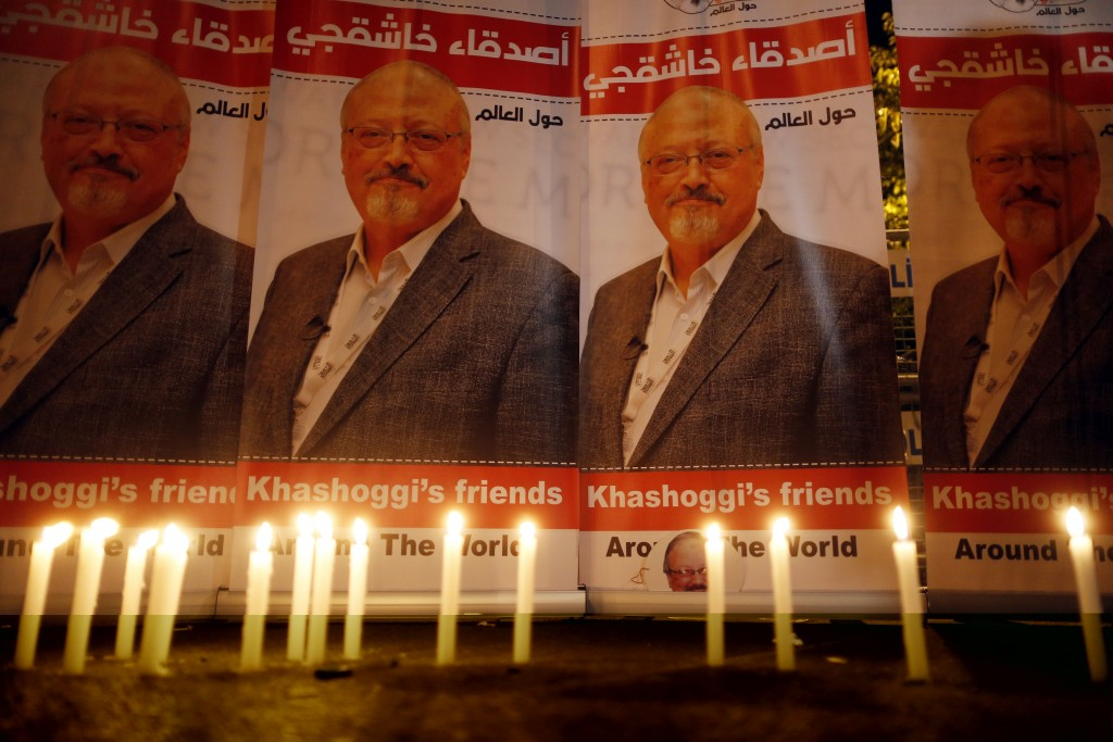FILE - In this Oct. 25, 2018, file photo, candles, lit by activists, protesting the killing of Saudi journalist Jamal Khashoggi, are placed outside Sa