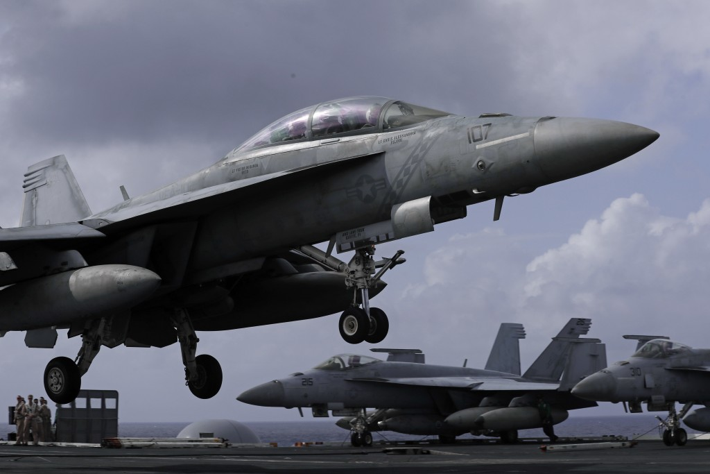 An F/A-18 Super Hornet fighter jet lands on the deck of the U.S. Navy USS Ronald Reagan in the South China Sea, Tuesday, Nov. 20, 2018. China is allow