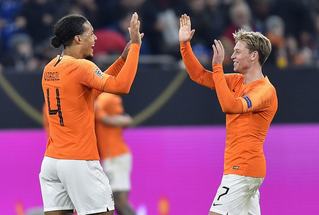 Netherland's Virgil Van Dijk, left, and Netherland's Frenkie De Jong celebrate after the UEFA Nations League soccer match between Germany and The Neth...