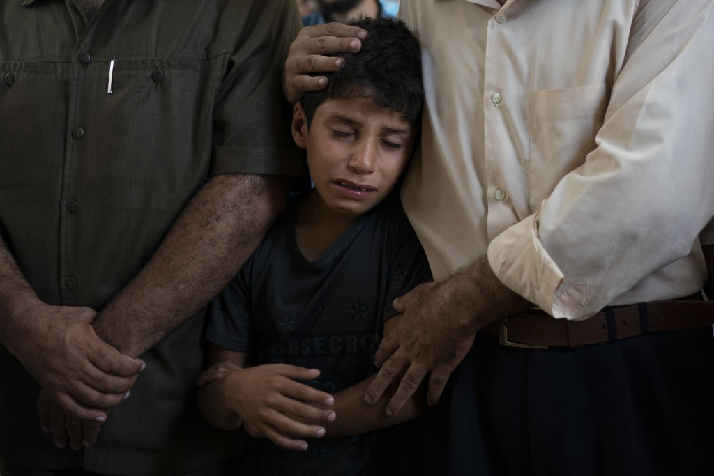 In this Sept. 15, 2018 photo, 11-year-old Mahmoud Abdel-al, cries during the funeral of his twin brother Shady Abdel-al in Beit Lahiya, northern Gaza ...